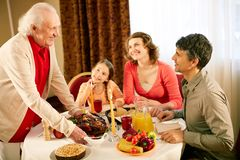 Gathered at dinner table Royalty Free Stock Image