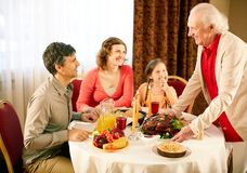 Gathered at dinner table Royalty Free Stock Photography