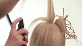 Gathered hair. Hairstyle for long white hair. White. Close up stock video