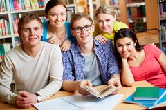 Gathered in library Royalty Free Stock Photos