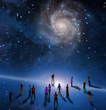 The Gathering. People gather in mystery Sci fi like scene Royalty Free Stock Image