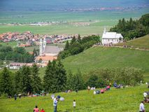 Gathering catholic pilgrims to celebrate the Pentecost, local cathedral in the background. royalty free stock photography