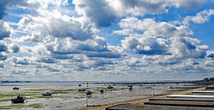 Gathering clouds dwarf the longest pleasure pier in the world. royalty free stock photography