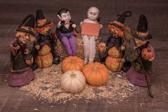 Vampire, Mummy and witches are planning a halloween party royalty free stock photos