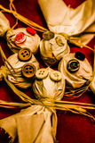 Gathering of ghosts. Close up of scary dolls made of sackcloth and buttons laying together in a circle of mysticism. Gathering of ghosts Royalty Free Stock Image
