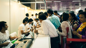 Gathering of people in registration counter Royalty Free Stock Photo
