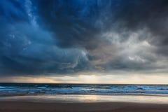 Gathering storm on beach Stock Image