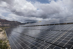 Gathering Storm Clouds Over Desert Solar Panels Stock Photos