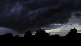 Gathering Storm. Threatening storm clouds begin to dump their load over Dagenham Royalty Free Stock Photo