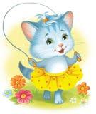 Gatito con una cuerda que salta Gatito en un paseo Gato en una falda Foto de archivo