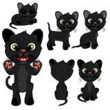 Gatito negro en diversas actitudes en estilo de la historieta Foto de archivo libre de regalías