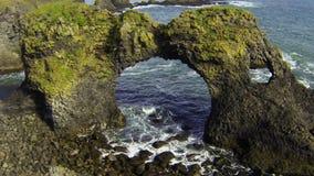 Gatklettur - Arch rock. Arch rock Gaktlettur in Arnarstapi, Snaefellsnes peninsula, Iceland stock footage