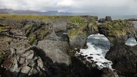 Gatklettur - Arch rock. Arch rock Gaktlettur in Arnarstapi, Snaefellsnes Peninsula, Iceland stock video