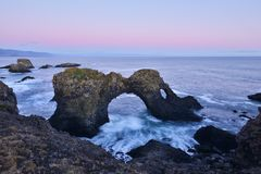 Gatklettur at autumn sunset, an  Arch Rock, west Iceland Stock Images