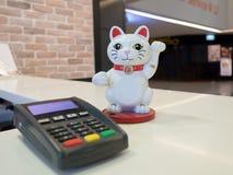 Gato de Fourtue e terminal da posição Fotografia de Stock