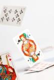 Gato del póker que cae Imagen de archivo libre de regalías