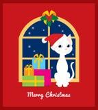 Gato do Natal na janela Fotografia de Stock Royalty Free