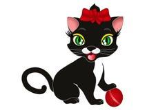 Gato negro de la historieta que juega con una bola Foto de archivo