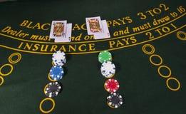 Gato negro del casino imagenes de archivo