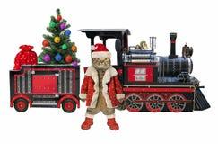 Gato perto do trem do Natal foto de stock royalty free