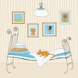 Gato que duerme en cama Foto de archivo libre de regalías