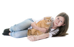 Gato y adolescente del jengibre Foto de archivo libre de regalías