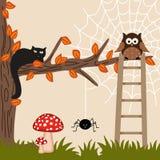Gato y buho en árbol Imagenes de archivo