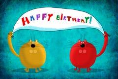 Gatos de la tarjeta de cumpleaños dos que llevan a cabo el cartel de los saludos Imagenes de archivo