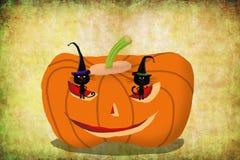 Gatos de la tarjeta de Halloween en la cabeza de la calabaza Fotografía de archivo libre de regalías
