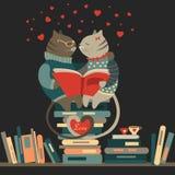 Gatos no amor que leem um livro Fotografia de Stock Royalty Free