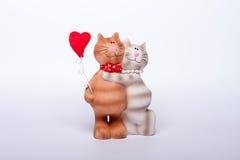 Gatos y corazón Fotos de archivo
