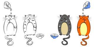 gatos y leche Imagen de archivo libre de regalías