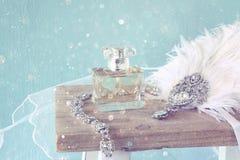 Gatsby style head decoration next to perfume bottle Stock Image