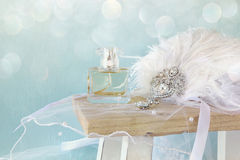 Gatsby style head decoration next to perfume bottle Stock Photo