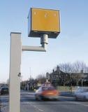 Gatso speed camera with speeding vehicles Royalty Free Stock Image