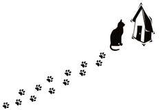 Gatto e le sue stampe della zampa Fotografie Stock Libere da Diritti