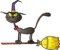 Gatto nero che pilotano una scopa Immagini Stock Libere da Diritti