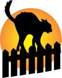 Gatto nero su una rete fissa Immagini Stock Libere da Diritti