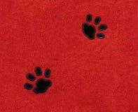 Gatto Pawprints su tessuto Fotografia Stock