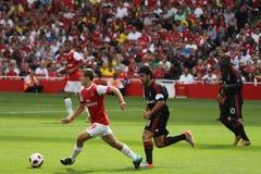 Gattuso chasing Wilshere Royalty Free Stock Image