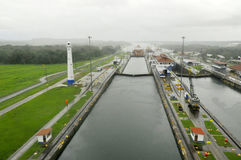 GATUN LOCKS. PANAMA CANAL-NOV. 7:This is the first set of locks situated on the Atlantic entrance of the Panama Canal. On nov. 7 2012 in Panama. Ships are Royalty Free Stock Photo