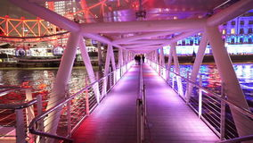 Gatway to London Eye pier colorful illuminated at night. LONDON, ENGLAND stock video