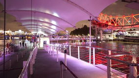 Gatway to London Eye pier colorful illuminated at night. LONDON, ENGLAND stock video footage