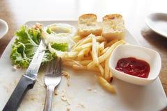 Gauche au-dessus de nourriture de plat Photographie stock