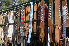 Gaucho Belts. Traditional Argentinean leather gaucho belts and cinchs hanging on for sale on a fair in Rosario city, Argentina stock image