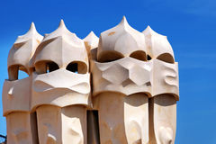 Gaudi Chimneys statues at Casa Mila (also called La Pedrera) in Barcelona. Terrace of the Casa Mila, with chimneys shape Royalty Free Stock Photography