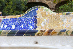 Gaudi multicolored mosaic bench  in Park Guell; Barcelona; Spain Stock Image