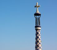 Gaudi's cross in blue sky Stock Photo