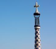 Gaudi's cross in blue sky Stock Photo
