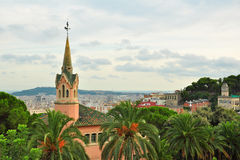 Gaudi's house with tower in Park Guell, Barcelona. Last home of Gaudi surrounded by palm trees, in Park Guell, with high cityscape view of Barcelona, Spain Stock Image